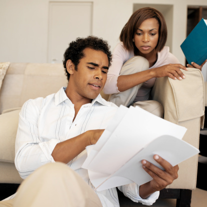 African American couple reading documents