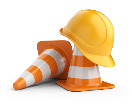 construction cones and hard hat