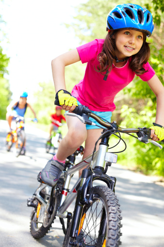girl riding bike in homeowners association resized 600