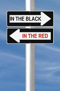 In_the_red_in_the_black_arrow_signs
