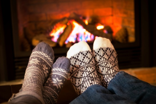 feet_warming_by_fireplace