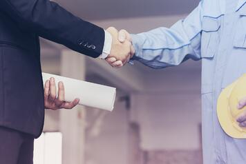 architect shaking hands with businessman