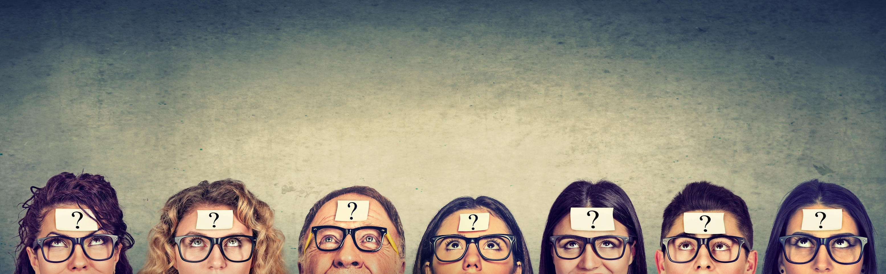 group of people thinking with question marks on foreheads