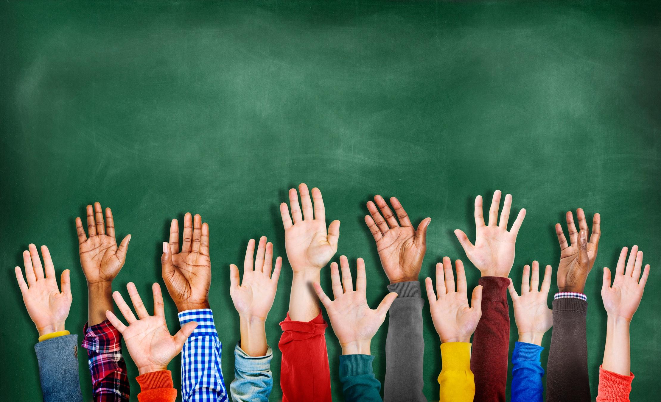 group of raised hands - ThinkstockPhotos-522259145