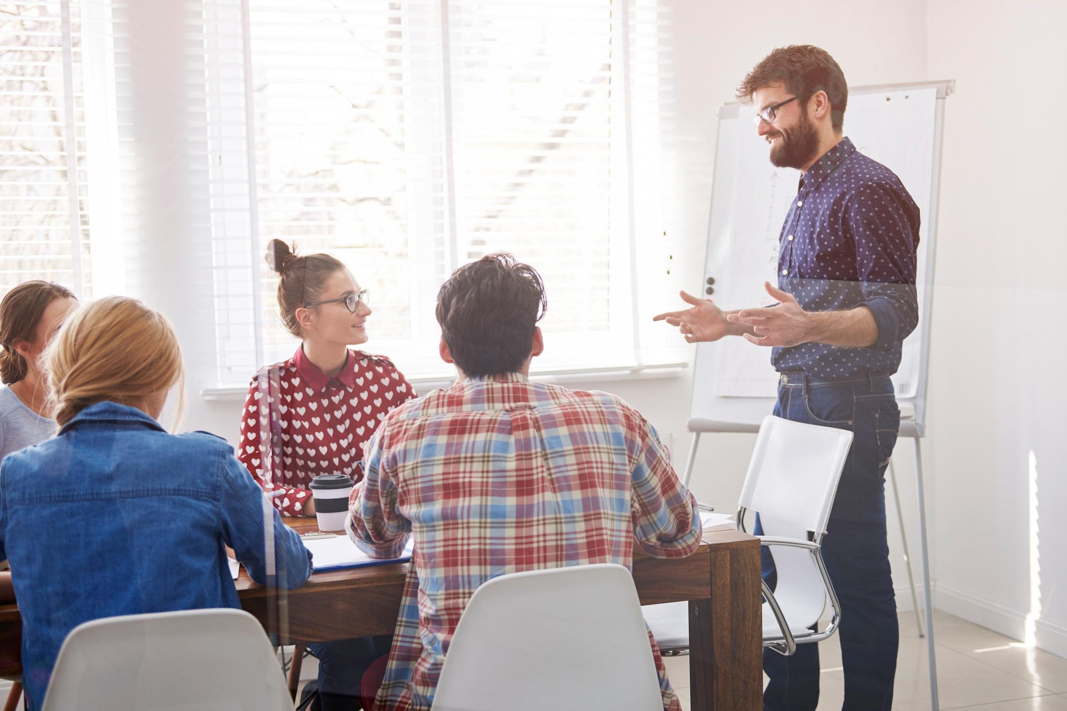 man-presenting-at-a-meeting